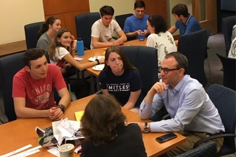 Hebrew speakers and learners gather over pizza to discuss Rosh Hashanah and other engaging topics.